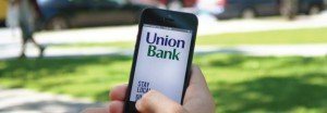 Union Bank online banking website displayed on a smartphone in a person's hand